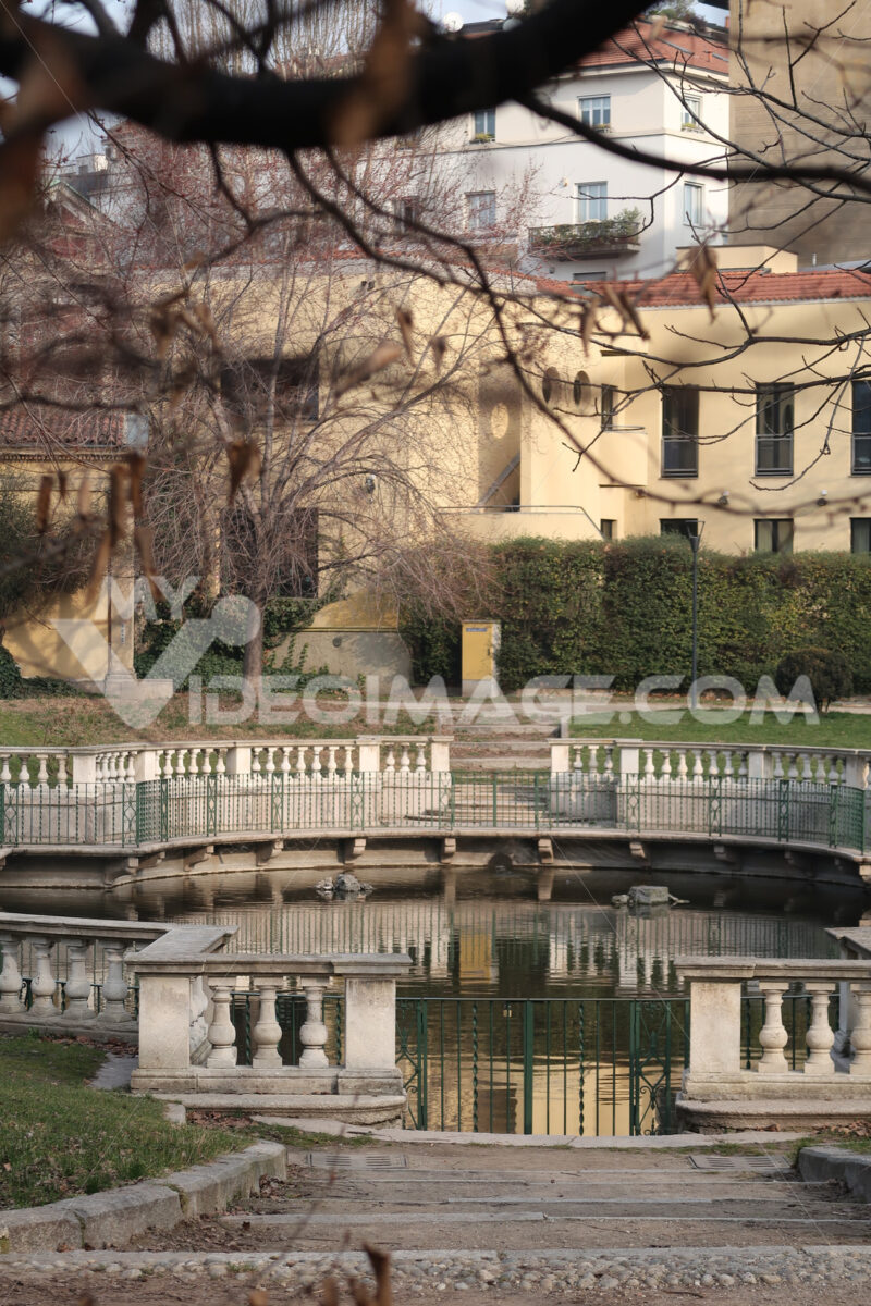 Water tank in the Guastalla gardens in Milan. Traditional Italian garden with a pond in the city center. - MyVideoimage.com