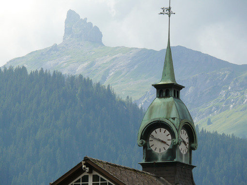 Wengen, Switzerland. Mountain and church with clock. - MyVideoimage.com