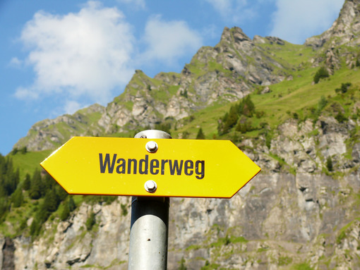Wengen, Switzerland. Mountain trail signpost. Foto Svizzera. Switzerland photo