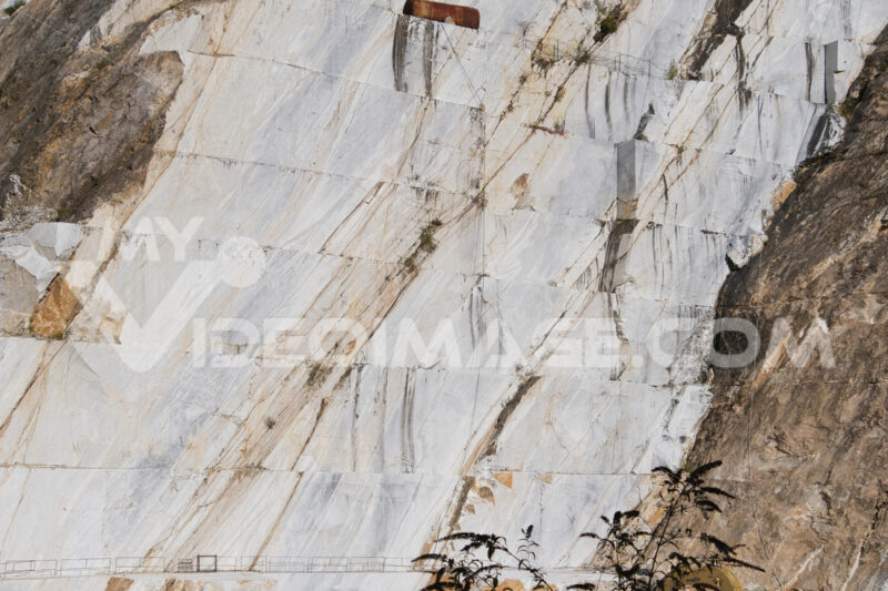 White Carrara marble quarry in the Apuan Alps in Tuscany. Mountain walls cut with diamond wire. - LEphotoart.com
