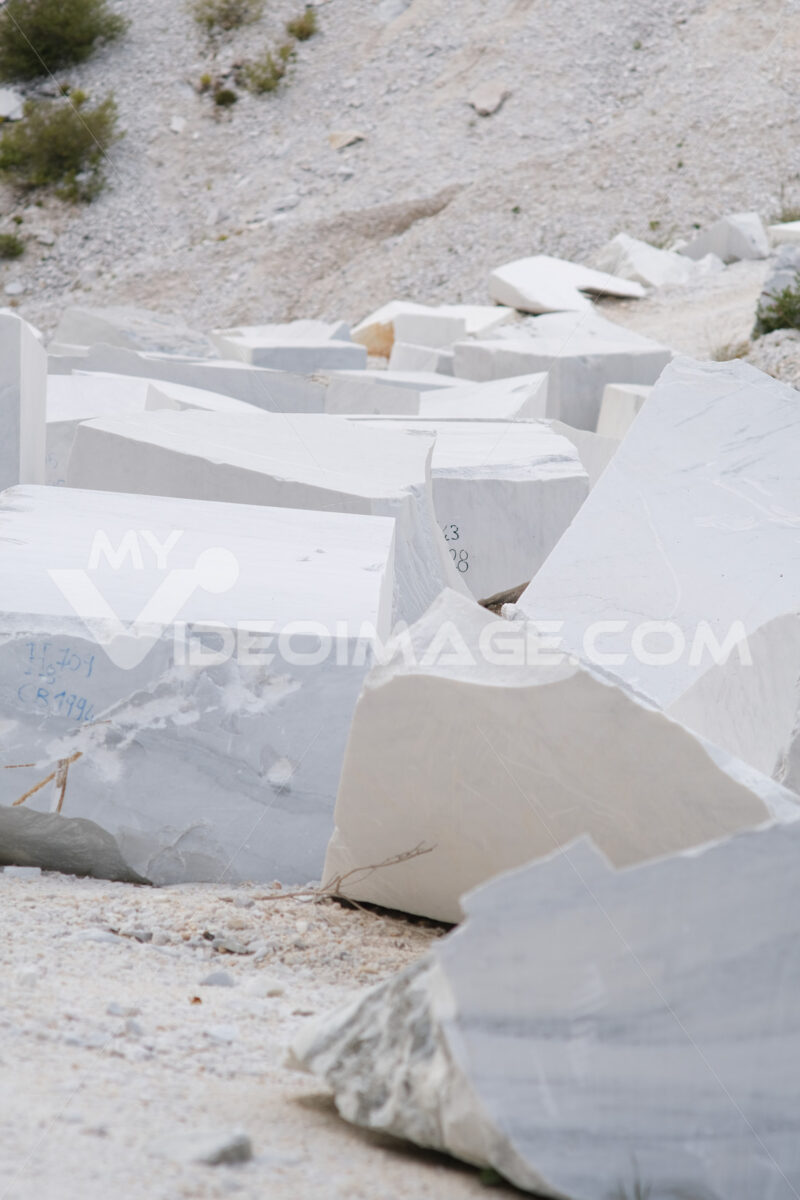 White marble bloks. Blocks of white Carrara marble deposited in a square near the quarries. Stock photos. - MyVideoimage.com | Foto stock & Video footage