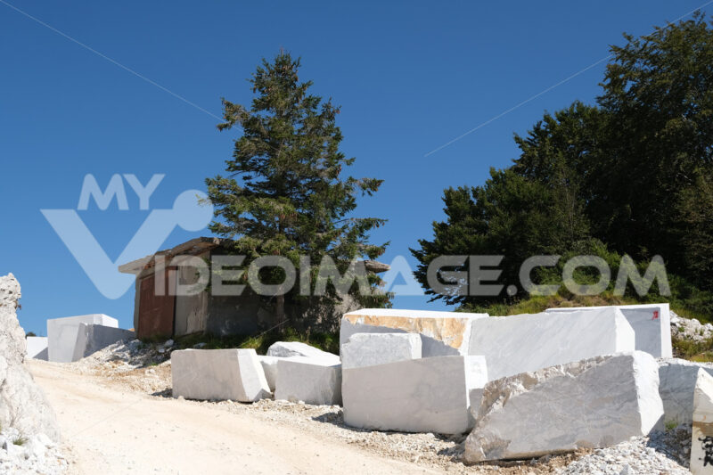White road. Dirt road in a white marble quarry from Alta Versilia. Apuan Alps. - MyVideoimage.com | Foto stock & Video footage