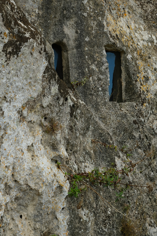 Window with glass in a cave in the Sassi of Matera. - MyVideoimage.com