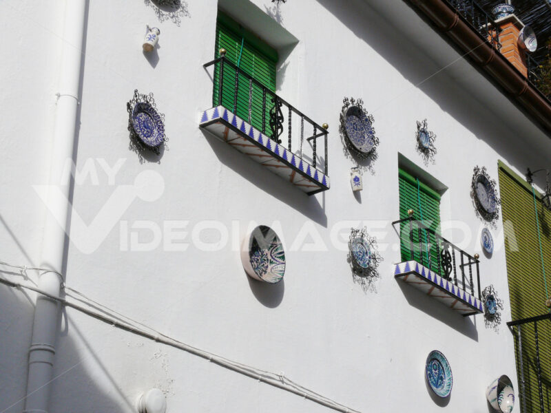 Window with sunblind curtain and facade with ceramic decorations - MyVideoimage.com