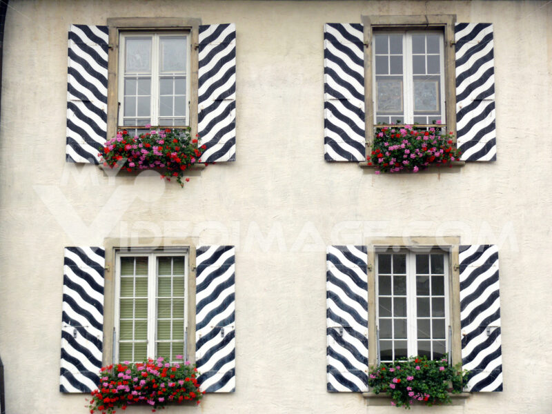 Windows with striped decorated shutters - MyVideoimage.com