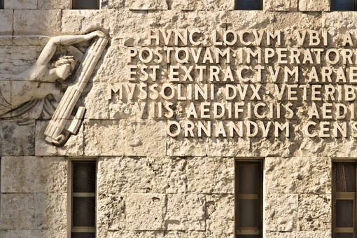 Written from the fascist era engraved on stone in the facade of the building. - LEphotoart.com
