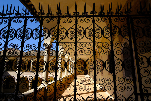 Wrought iron grille in the cloister of the church of San Francesco in Assisi. - LEphotoart.com