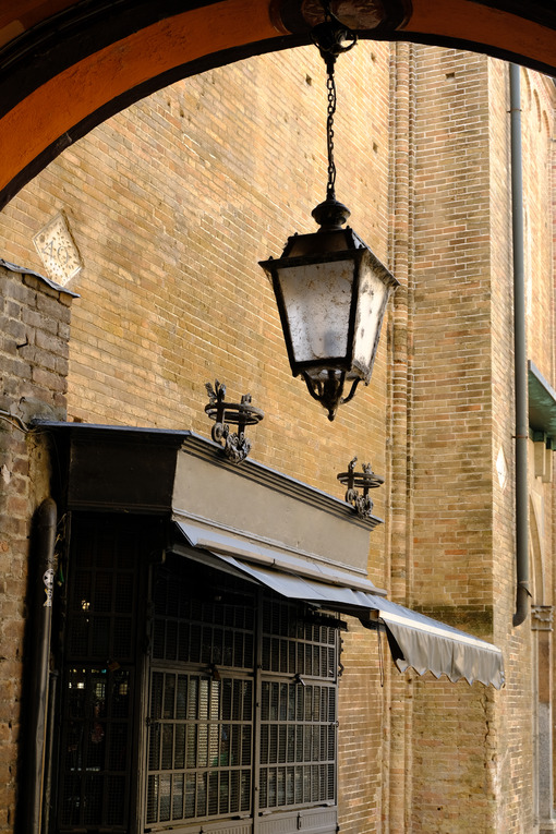 Wrought iron shop shutter and lantern. - MyVideoimage.com | Foto stock & Video footage