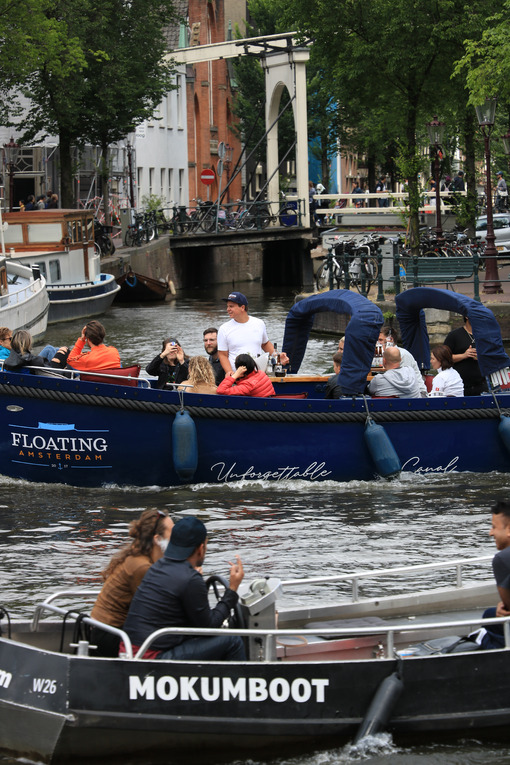 Young people on a tourist trip on a boat in the city canals. - MyVideoimage.com